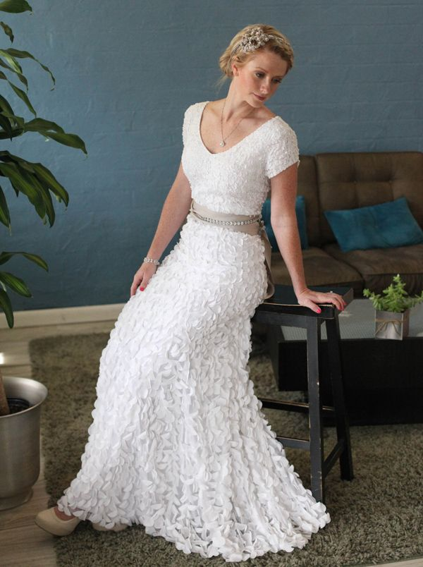 Cute!  And I like the ribbon at the waist!  But maybe not the sleeves...Refreshed and Refined: New Modest Wedding Dresses