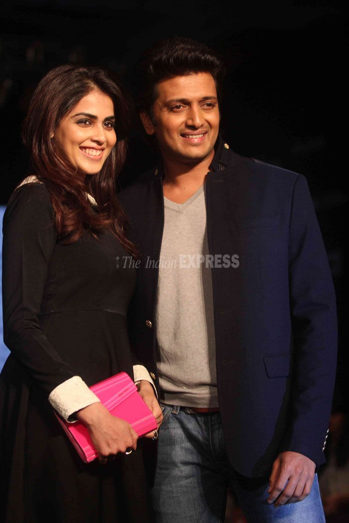 Genelia D'Souza is all smiles as she strikes a pose along with husband Ritesh Deshmukh. #Bollywood #Style #Fashion #LFW
