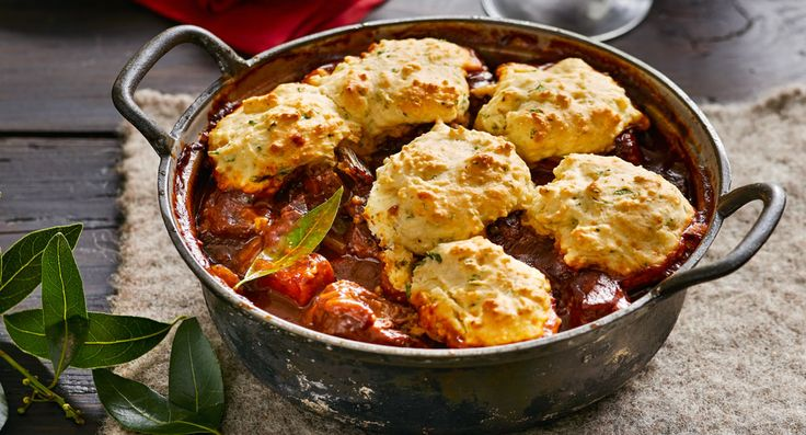 Tender beef cooked in a bottle of  red wine is made all the more rich and delicious with soft, fluffy dumplings  that soak up the decadent sauce.