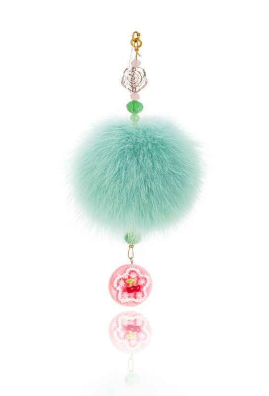 Pompon mobile Charm with 7cm bright green real fox fur, mobile clip, crystal beads and decorative elements. Price: 21.00E