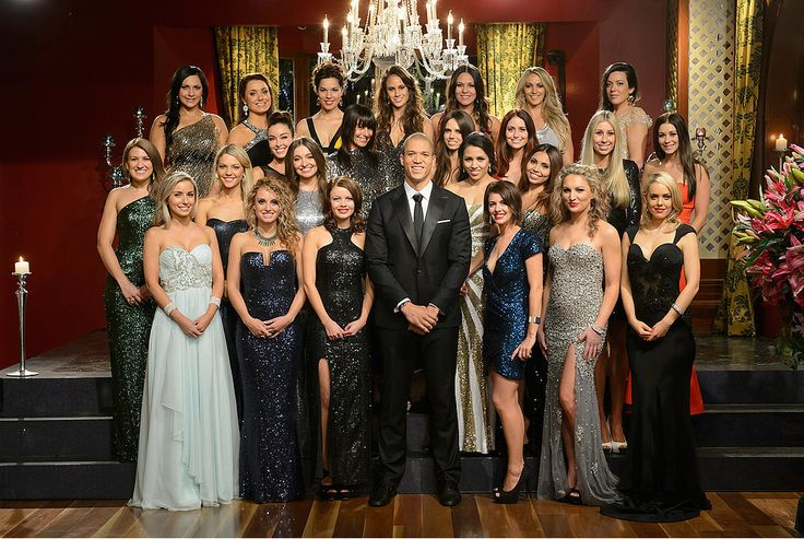 The Bachelor group shot with one of our chandeliers - from Designer Chandelier