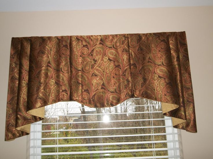 Soft and shimmery board mounted valance with contrasting lining.