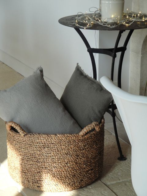 I like this idea of putting pillows into a basket as decor in living room or bedroom