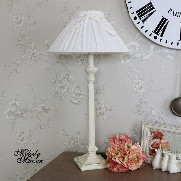 Cream Pleated Linen Table Lamp Cream table/bedside lamp with pleated shade in an antique style The linen shade is finished off with a ribbon tied top Suitable for a bedroom or a day room to help finish of a country style look home Bulb Max 40W Bulb - Bayonet bulb fixing