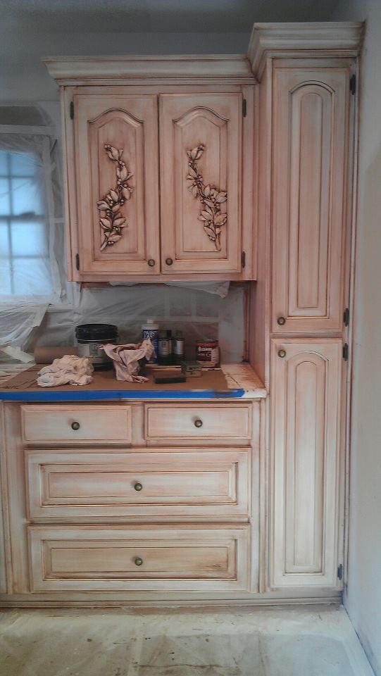 Kitchen cabinets in Laurel Leaf Faux carving and Charred Gold