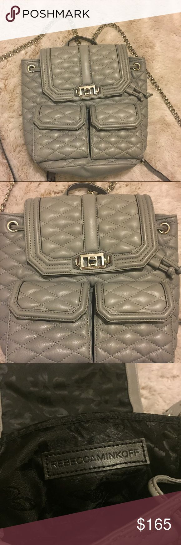Rebecca Minkoff Grey Quilted Leather Mini Backpack A cute Rebecca Minkoff grey quilted leather backpack, this backpack is in perfect condition no signs of wear or pen stains, a cute butterfly black print is on the inside. It had two magnet closing pockets on the front a drawstring to close and a polished turn lock that fastens the top. The straps are silver chain and are adjustable! The material is Quilted cowhide  Height 10.25in/26cm Length—10.25in/26 cm Depth-3.5in/9cm Rebecca Minkoff Bags…