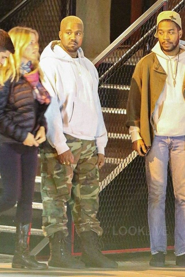 Kanye West wearing  Champion Reverse Weave Hooded Sweatshirt, Yeezy Season 2 Military Boots