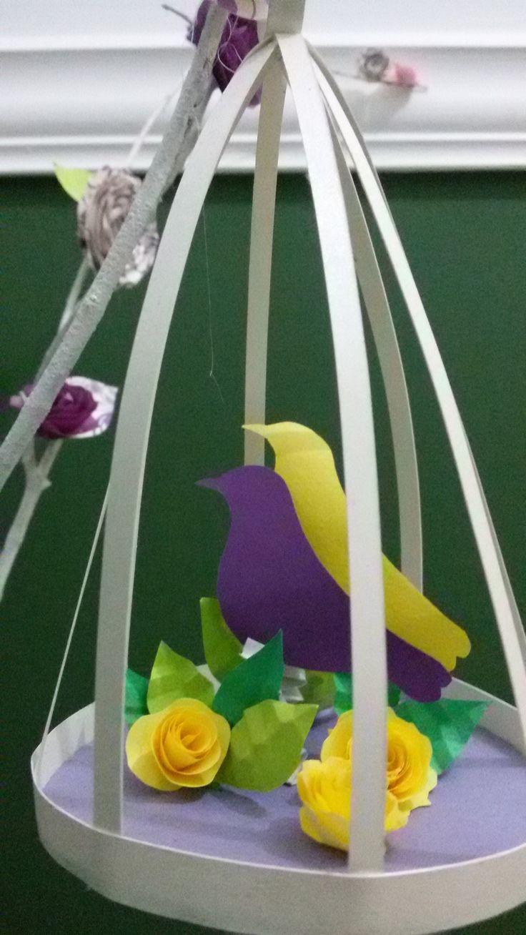Jaula con canarios de papel