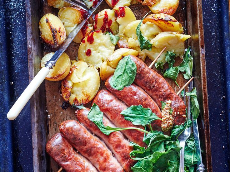 "The best way to cook sausages is to roast them low and slow. This way they don't burst, the skins get gorgeously caramelised and the insides get perfectly cooked. This recipe is a great ""roast"" for when there's just one or two people at home"