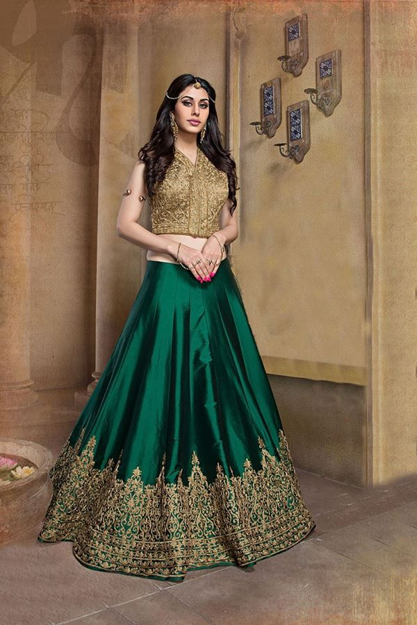 SHOP in USA - A-line lehenga choli, Designer lehenga choli, Wedding Lehenga Choli, Bridal Lehenga Choli - Freedom lies in being bold and fashionable. Stand out from the rest as you wear this beige and green color A line lehenga choli. Choli is of net and bottom portion of lehenga is engraved with zari-pitta work in pretty design. Authentic color combination is used to design this piece by making it worth flaunting. Matching dupatta accompanied is of net fabric. To keep yourself in spotlight…