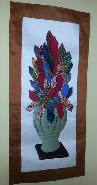 My mother made me this wall hanging made with repurposed neckties that my father used to wear to his job as a professor. Such a special gift and wonderful way to reuse old neckties! | eco-friendly crafts | sewing project | vintage neckties