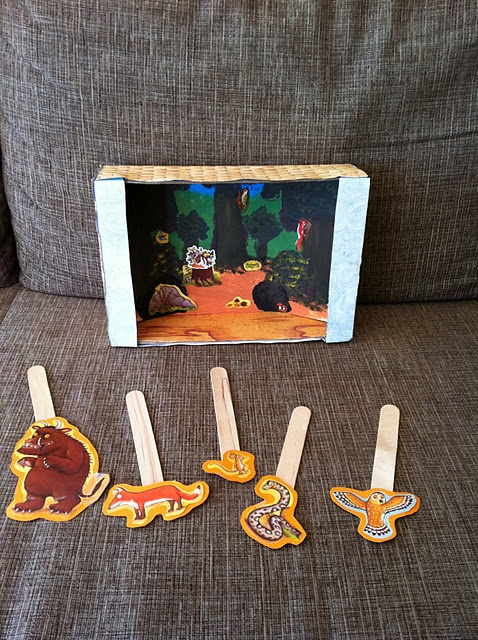 Puppet theater from a box - make the characters of the story, stick them onto a lolly stick and retell the story