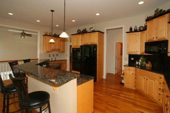 Open Floor Plan Kitchen Maple Cabinets With Black Crown Moulding Define Our Kitchen Black