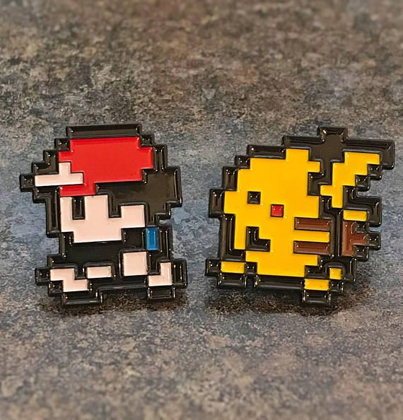 Classic Pokemon enamel pins in the style of Ash and Pikachu as depicted in the classic Game Boy Red/Blue/Yellow games!  Approx 25mm x 25mm Any questions, please ask!    Gotta catch em all