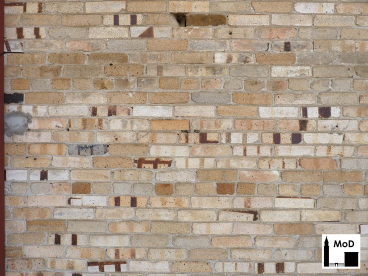 Beige And Peach Colored Flashed Brick With Iron Spots Side Wall Of The