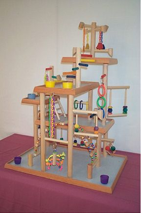 A bird-play-gym mansion. Just in case your pet isn't spoiled enough. My little birdie would love this!