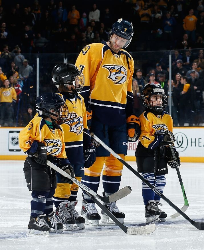 MARCH 5, 2015: Matt Cullen #7 of the Nashville Predators stands with his boys Wyatt, Brooks and Joey during the National Anthem prior to a game against the New York Islanders