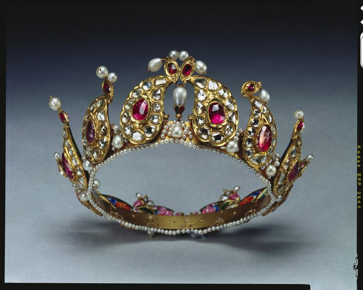 Twelve tear-shaped sections of  ruby, diamond and pearl set in gold form this unique tiara with enamel portraits at back. Presented to Queen Victoria & placed among Indian Collection belonging to Crown by King George V in 1924.