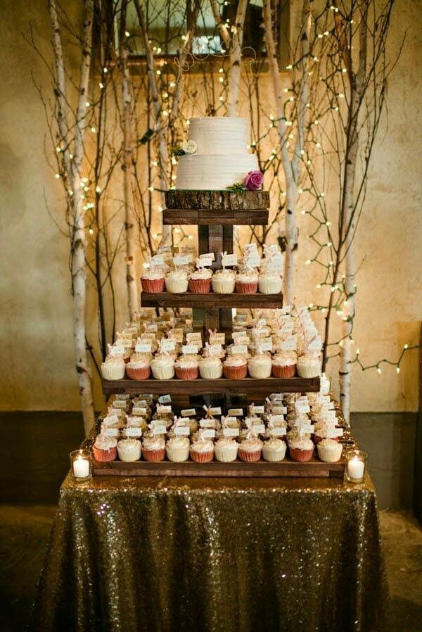 Small cake with cupcakes. Idea for wedding cake style!