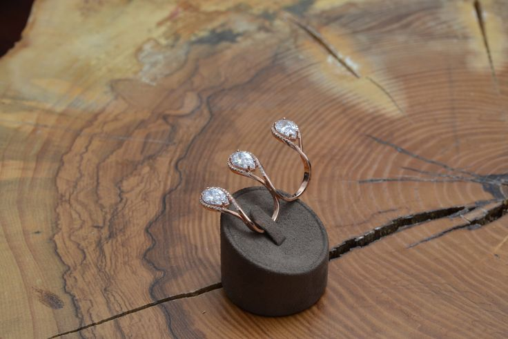 A personal favourite from my Etsy shop https://www.etsy.com/listing/293492717/elegant-two-finger-ring-silver-drops