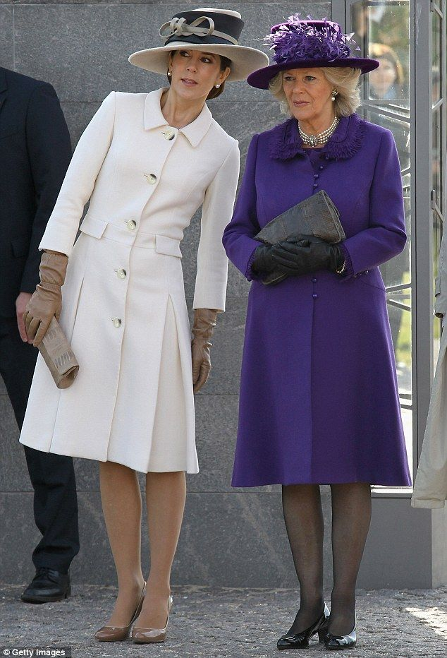 Duchess of Cornwall stunning in royal purple as she meets