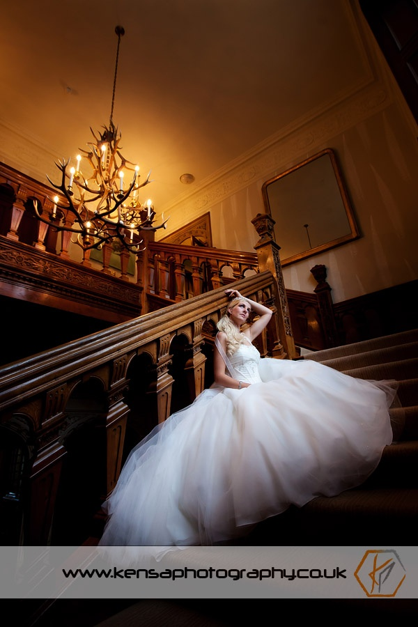 Bride on stairs at Bovey Castle - by Kensa Photography - www.kensaphotography.co.uk