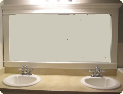 DIY - framed bathroom mirror - I actually did this in my house and ended up doing all the bathrooms because I liked it so much!  Super easy and no more than $20/mirror