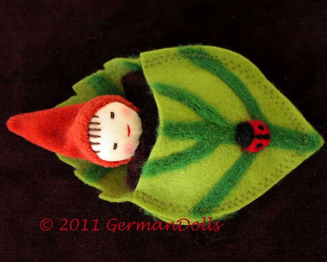 I like the idea of tucking a little doll into something....Leafbuddy lightgreen4 by germandolls, via Flickr