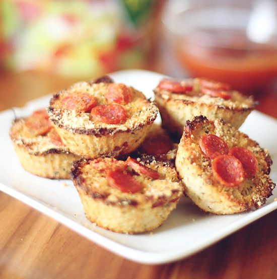 Mini Cauliflower Pizza Bites - who knew? These cauliflower pizza bites taste like a yummy combination of a piece of pizza and a breadstick all wrapped into a mini little bite.
