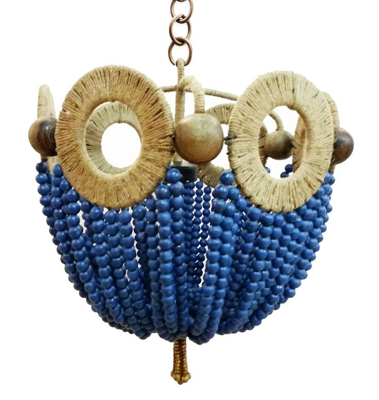 Florence love of circles inspired this playful blue beaded chandelier. Jute wrapped wire framed pendant with natural and blue wooden beads. #chandelier #beaded #blue