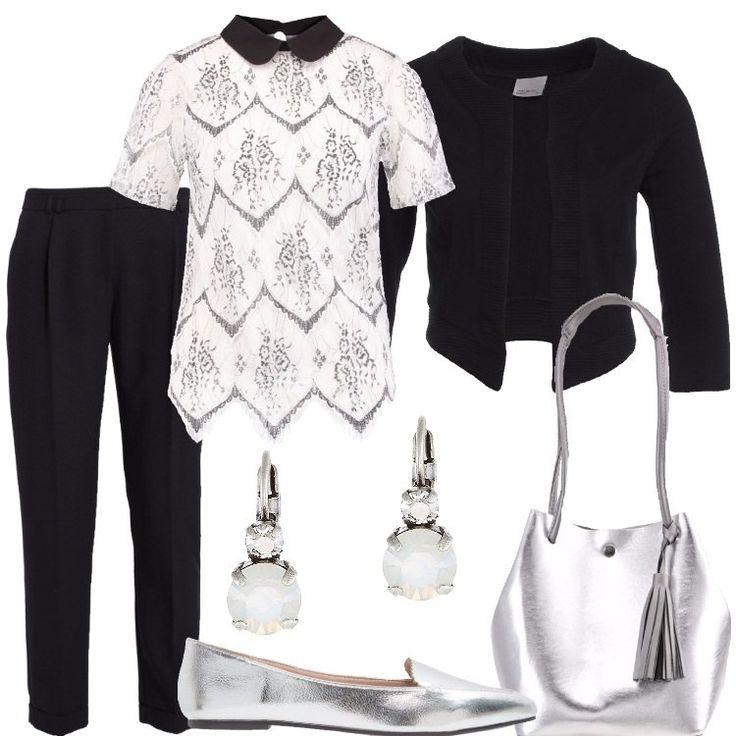 I+pantaloni+neri+hanno+le+tasche+laterali+alla+francese,+la+riga+ben+marcata+e+il+risvolto+e+sono+abbinati+ad+una+camicetta+bianca+a+maniche+corte,+e+foderata+su+dorso+e+schiena,+in+finto+pizzo,+con+colletto+nero.+Il+blazer+è+nero,+in+cotone+e+lavorato+a+costine+sui+bordi.+La+borsa+a+secchiello+in+finta+pelle+come+le+ballerine+e+gli+orecchini,+adornati+da+una+pietra+bianca,+sono,+invece,+in+argento.
