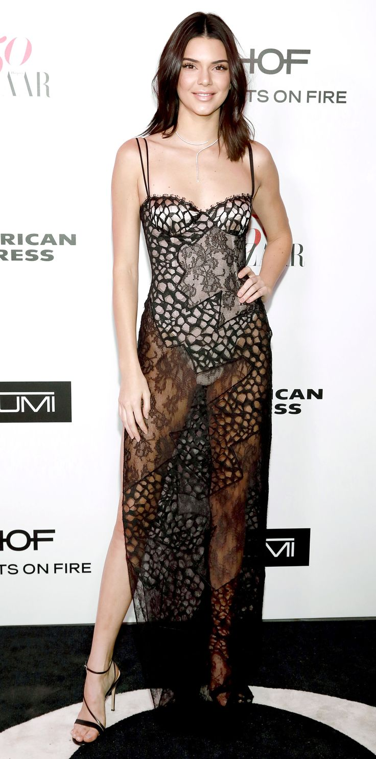 Gown or lingerie? Kendall Jenner took the see-through trend to transparent heights with a sheer black lace slip dress styled with a nude bodysuit underneath, a Mattia Cielo diamond necklace, and delicate black strappy sandals.
