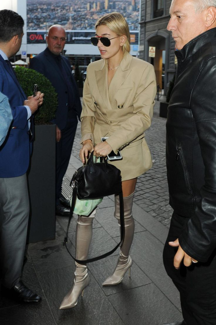 Hailey Baldwin wearing Acler Ordon Obi Corset Blazer, Givenchy Micro Nightingale Bag, Thom Browne Gold Mirrored Sunglasses and Tony Bianco Dene Boots in Blonde Stretch Satin