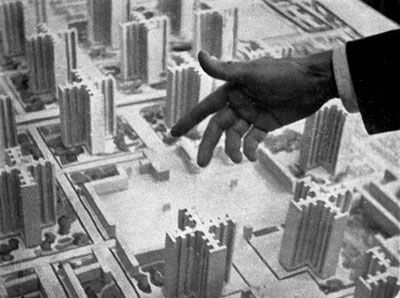 """Le Corbusier Dynamites waves his hand over his vision for """"La Ville Radieuse,"""" 1964"""