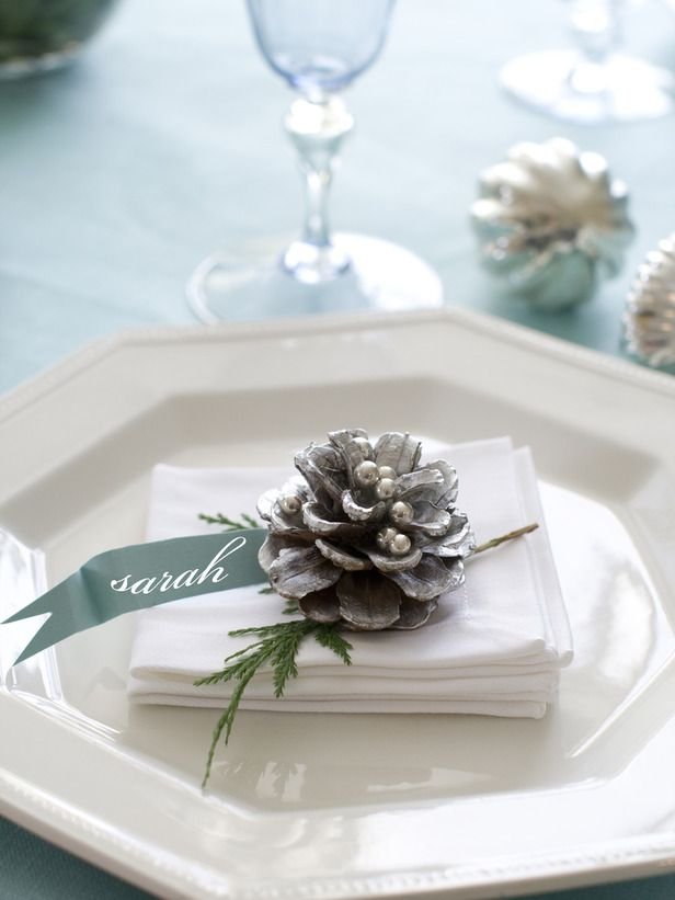 Pinecone Settings -- Each place setting can be dressed up with a pinecone and name tag cut from scrapbook paper and attached to a whitewashed pinecone studded with silver dragees.