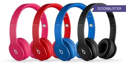 Beats by DRE solo HD drenched headphones with a mic