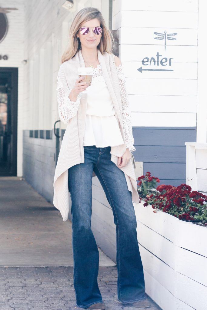 neutral outfit: white off the shoulder top and drape front vest with flare denim