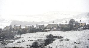 Houses in Buxton after wintry weather brought snow to high ground across the Peak District