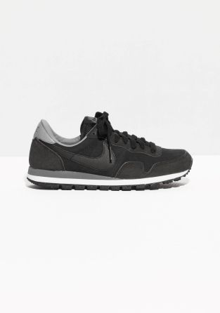 Cushioned collar for comfort and ankle protection Double-layered EVA wedge midsole Rubber waffle outsole for traction