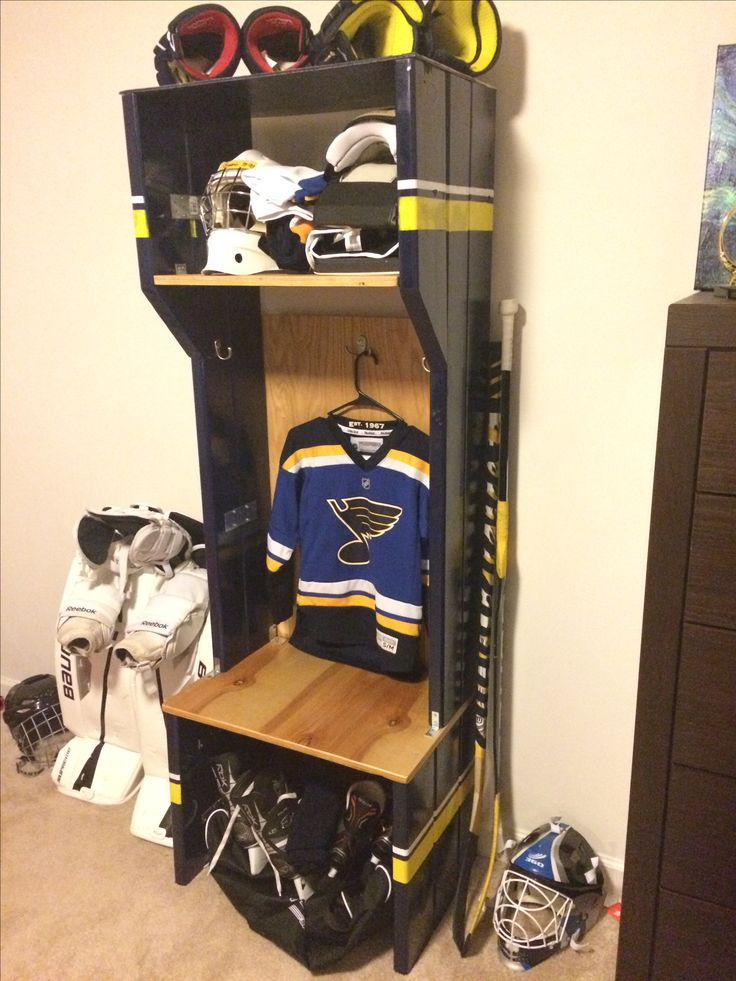 Hockey Locker made from an old bunk bed.                                                                                                                                                                                 More