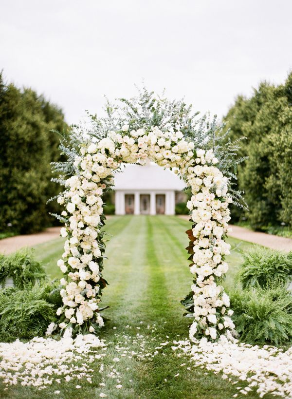 Elegant White Rose Ceremony Arch | photography by katiestoops.com/ | wedding planning by www.bellwetherevevents.com