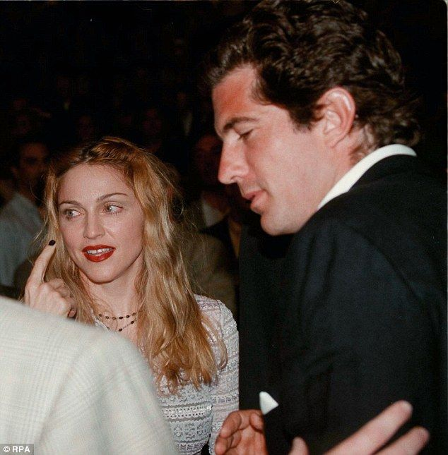 Relationship: John F Kennedy Jr and Madonna, pictured here in 1996, had an affair following the breakdown of her marriage to actor Sean Penn, a new book has claimed
