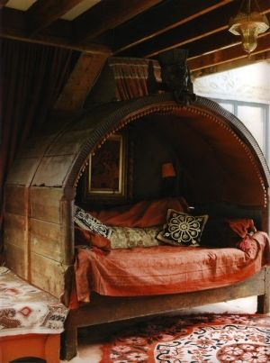 Would love to have a little nook like this. Wouldn't be too hard to build. Has the gypsy wagon look. could even be outside in the garden!