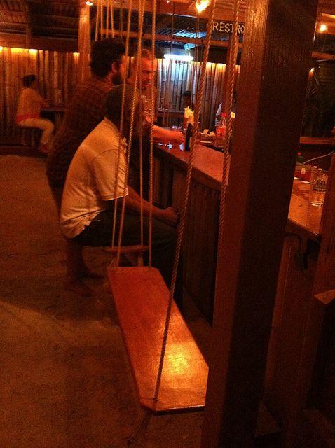 Need to go here! A bar with swings! Swings!! Caye Caulker by DangerousBiz, via Flickr