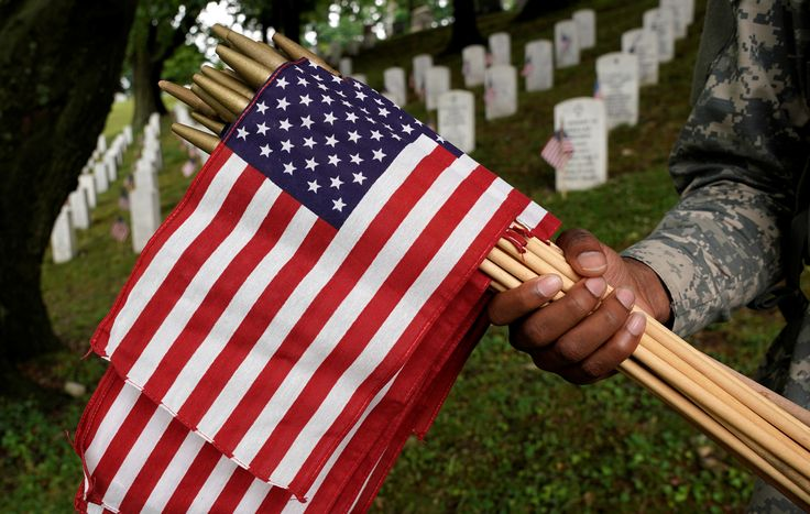 A soldier from the 3rd U.S. Infantry Regiment (Old Guard) holds a handful of flags during 'Flags-in,' where a flag is placed at each of the 284,000 headstones at Arlington National Cemetery ahead of Memorial Day, in Arlington, Virginia, U.S., May 25, 2017. REUTERS/Kevin Lamarque via @AOL_Lifestyle Read more: https://www.aol.com/article/news/2017/05/25/us-soldiers-plant-thousands-of-flags-at-cemetery-in-memorial-day/22110184/?a_dgi=aolshare_pinterest#fullscreen