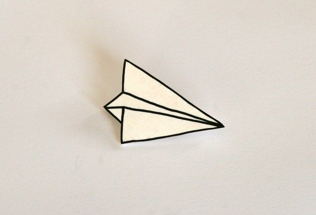 Paper plane brooch. Drawing class: make simple origami form. Draw it - define and refine line. Could trace onto shrink film and create brooch/ other