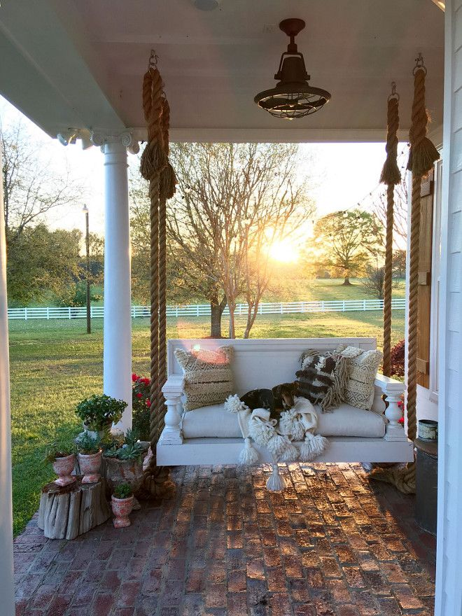 Porch with swing bed. Porch with swing bed with rope. We had the swing built, it is built out of a door from the 1800's! Brick Porch with swing bed. #Porch #swingbed #brickporch #brick Beautiful Homes of Instagram @cindimc.ivoryhome