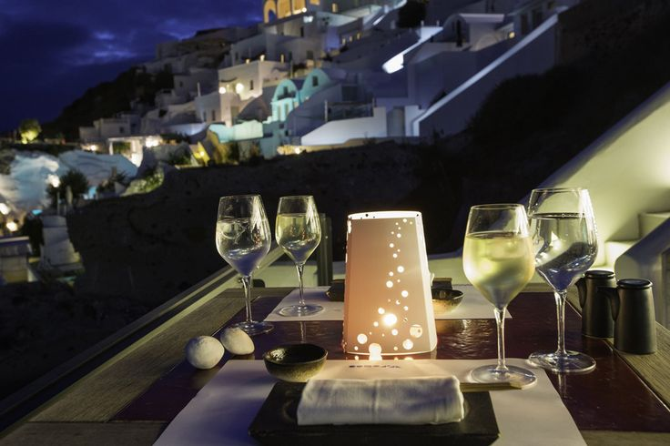 Nightime dinners are best served with wine and a view at Santorini Secret Suites & Spa