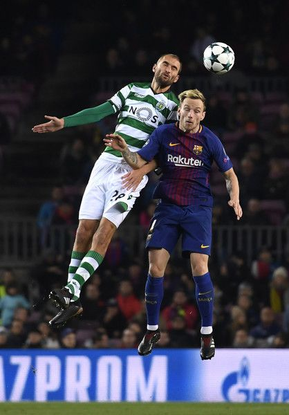 Bas Dost of Sporting Lisbon wins a header over Ivan Rakitic of Barcelona during the UEFA Champions League group D match between FC Barcelona and Sporting CP at Camp Nou on December 5, 2017 in Barcelona.