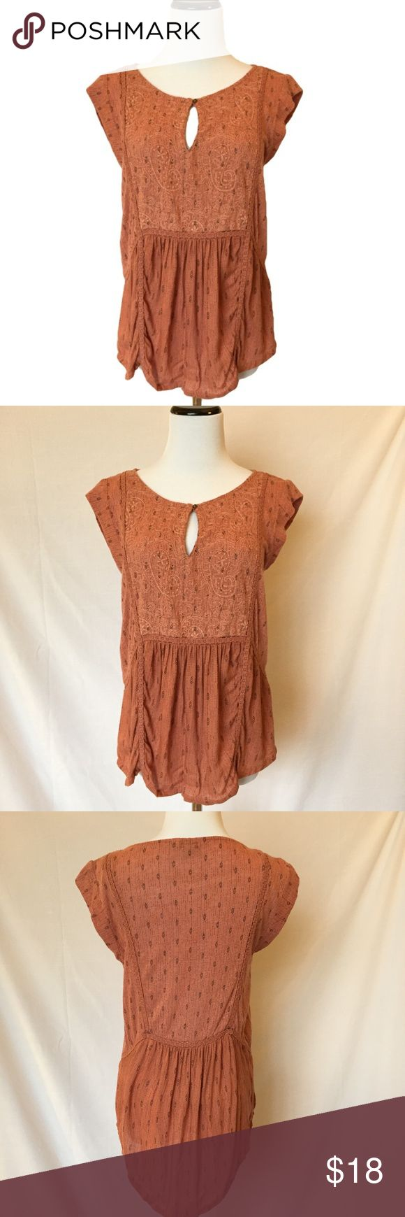 "Lucky Brand S keyhole cap sleeve linen/rayon This Lucky Brand cap sleeve key holed shirt is so soft.  The material is above the waist is more of a distressed worn out look, the bottom is same material, just not as distressed looking.  Embellished throughout with cotton crochet-like stitching. Back fall longer than front. The color is a rusty orangish/pink with black details. Bust- 17"" Length front- 24"" Length back- 27"" Lucky Brand Tops"